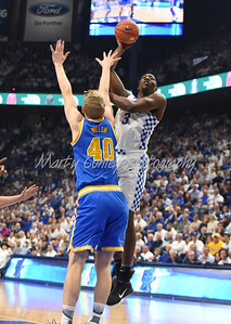 Kentucky's Bam Adebayo lofts a shot over UCLA's Thomas Welsh on Saturday afternoon at Rupp Arena.  MARTY CONLEY/ FOR THE DAILY INDEPENDENT