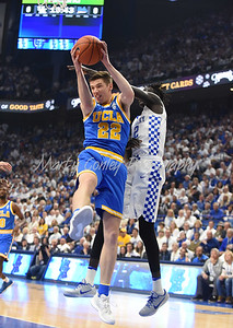 UCLA's TJ Leaf wins the battle for the rebound over Kentucky's Wenyen Gabriel on Saturday.  MARTY CONLEY/ FOR THE DAILY INDEPENDENT