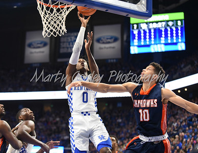 De'Aaron Fox of Kentucky drives to the basket as UT-Martin's Chandler Rowe defends.  MARTY CONLEY/ FOR THE DAILY INDEPENDENT