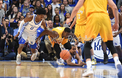 Kentucky's De'Aaron Fox and Isaiah Briscoe fight against Valparaiso's Max Joseph for a loose ball on Wednesday.  MARTY CONLEY/ FOR THE DAILY INDEPENDENT