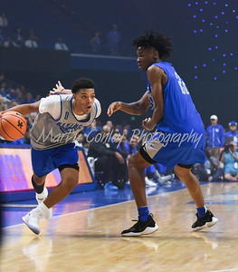Quade Green dribbles past Shai Gilgeous-Alexander on Friday evening during Kentucky's Big Blue Madness.  MARTY CONLEY/ FOR THE DAILY INDEPENDENT