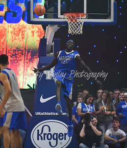 Kentucky's Wenyen Gabriel throws down a slam dunk on Friday during Big Blue Madness in Lexington.  MARTY CONLEY/ FOR THE DAILY INDEPENDENT