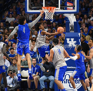 Kentucky's Shai Gilgeous-Alexander goes up and under past Nick Richards on Friday during the Blue-White game in Lexington.  MARTY CONLEY/ FOR THE DAILY INDEPENDENT