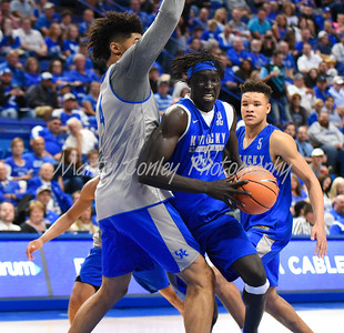 Kentucky's Wenyen Gabriel drives to the basket as Nick Richards defends on Friday during the Blue-White game.  MARTY CONLEY/ FOR THE DAILY INDEPENDENT