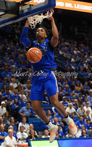 PJ Washington of Kentucky dunks the ball on Friday evening during UK's Blue- White game at Rupp Arena.  MARTY CONLEY/ FOR THE DAILY INDEPENDENT