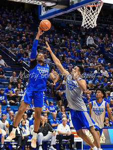 Kentucky's PJ Washington throws up a one handed shot over Sacha Killeya-Jones on Friday evening during Kentucky's Blue- White game at Rupp Arena.  MARTY CONLEY/ FOR THE DAILY INDEPENDENT