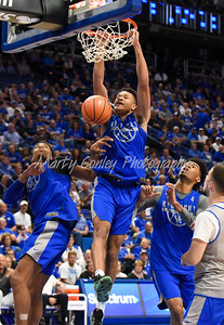 Kentucky's Kevin Knox dunks on Friday evening during UK's Blue- White game.  MARTY CONLEY/ FOR THE DAILY INDEPENDENT
