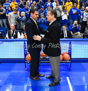 Kentucky head coach, John Calipari shakes the hand of Morehead's head coach, Preston Spradlin at center court on Monday evening.  MARTY CONLEY/ FOR THE DAILY INDEPENDENT