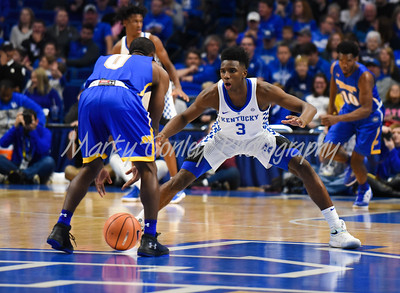 Kentucky's Hamidou Diallo defends Morehead's Adrian Hicks on Monday evening at Rupp Arena.  MARTY CONLEY/  FOR THE DAILY INDEPENDENT
