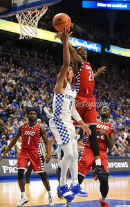 Kentucky's Quade Green throws up a shot as UIC's Tai Odiase defends on Sunday.  MARTY CONLEY/ FOR THE DAILY INDEPENDENT