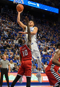 Kentucky's Kevin Knox puts up a one handed shot in the paint over UIC's Dikembe Dixson on Sunday.  MARTY CONLEY/ FOR THE DAILY INDEPENDENT
