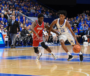Kentucky's Shai Gilgeous-Alexander drives with the ball past UIC's Marcus Ottey on Sunday.  MARTY CONLEY/ FOR THE DAILY INDEPENDENT