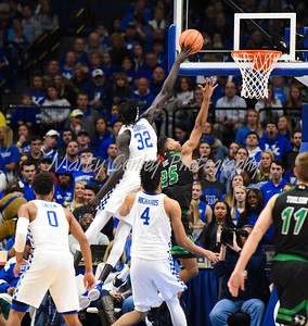 Kentucky's Wenyen Gabriel blocks the shot of Utah Valley's Kenneth Ogbe on Friday.  MARTY CONLEY/ FOR THE DAILY INDEPENDENT