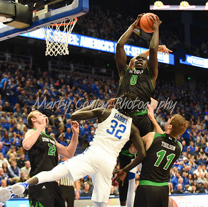 Utah Valley's Akolda Manyang goes up for a rebound over Kentucky's Wenyen Gabriel on Friday evening.  MARTY CONLEY/ FOR THE DAILY INDEPENDENT