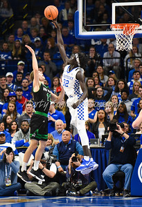 Kentucky's Wenyen Gabriel blocks the shot of Utah Valley's Conner Toolson on Friday evening in Lexington.  MARTY CONLEY/ FOR THE DAILY INDEPENDENT