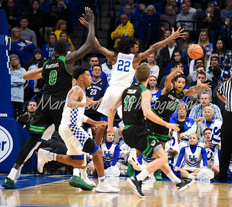 Ben Nakwaasah of Utah Valley throws the ball inbounds past Kentucky's Shai Gilgeous-Alexander on Friday evening.  MARTY CONLEY/ FOR THE DAILY INDEPENDENT