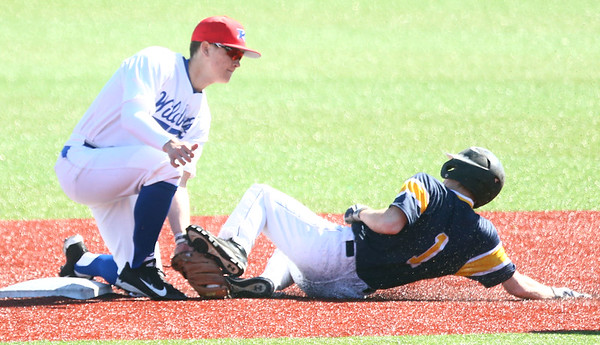 4-8-17<br /> Kokomo baseball vs SB Riley<br /> Bayden Root gets SB Riley's Tyler Schupert out at second.<br /> Kelly Lafferty Gerber | Kokomo Tribune