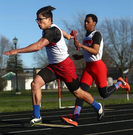 4-7-17<br /> Kokomo boys track and field<br /> Chris Thomas passes the baton to Joseph Nieto in the 4x1 relay.<br /> Kelly Lafferty Gerber | Kokomo Tribune