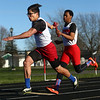 4-7-17<br /> Kokomo boys track and field<br /> Chris Thomas passes the baton to Joseph Nieto in the 4x1 relay.<br /> Kelly Lafferty Gerber | Kokomo Tribune