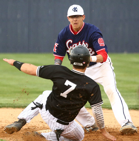 4-26-17<br /> Cass vs Western baseball<br /> Cass' Reece Rodabaugh gets Western's Tyler Burthay out at second.<br /> Kelly Lafferty Gerber | Kokomo Tribune