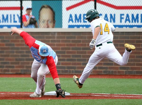 4-27-17<br /> Eastern vs Maconaquah baseball<br /> Eastern defeated Maconaquah in 5 innings, 13-3. Logan Beall gets to first safely after Maconaquah's Adam Bowman misses the catch.<br /> Kelly Lafferty Gerber | Kokomo Tribune