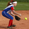 4-11-17<br /> Kokomo vs Taylor softball<br /> Kokomo's Kiley Trine scoops up the ball and throws to first for an out.<br /> Kelly Lafferty Gerber | Kokomo Tribune
