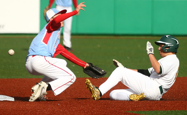 4-27-17<br /> Eastern vs Maconaquah baseball<br /> Eastern defeated Maconaquah in 5 innings, 13-3. Eastern's Logan Beall slides safely to second as the ball flies past Maconaquah's Cody Koebler.<br /> Kelly Lafferty Gerber   Kokomo Tribune