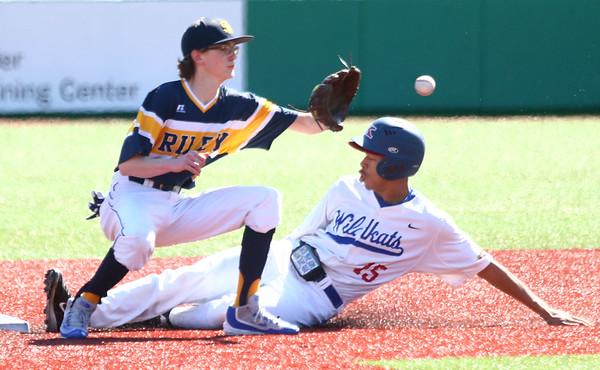 4-8-17<br /> Kokomo baseball vs SB Riley<br /> Perry McCullum slides safely to second before SB Riley's Sam Moran can get him out.<br /> Kelly Lafferty Gerber | Kokomo Tribune