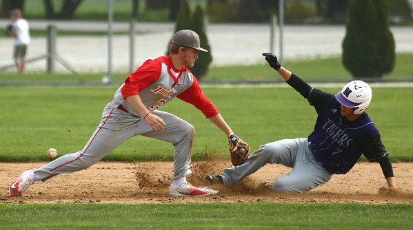 4-15-17<br /> Northwestern vs Mississenewa baseball<br /> NW's Thomas Crocker slides safely to second base before Miss. Cade McCoin can apply the tag.<br /> Kelly Lafferty Gerber | Kokomo Tribune
