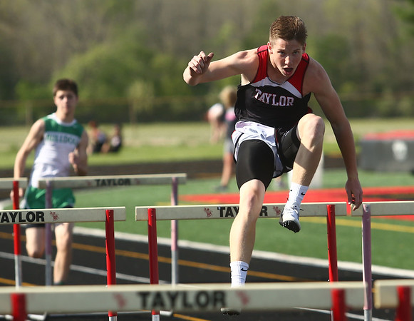 4-25-17<br /> Taylor track<br /> Clay Brubaker in 110 m hurdles<br /> Kelly Lafferty Gerber | Kokomo Tribune
