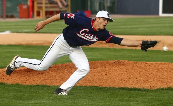 4-26-17<br /> Cass vs Western baseball<br /> Cass pitcher Alec Eurit just misses the catch.<br /> Kelly Lafferty Gerber | Kokomo Tribune