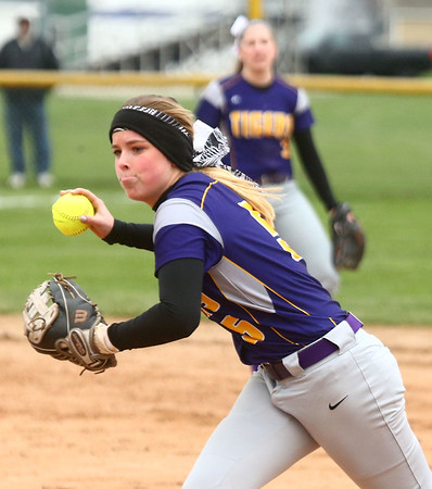 2-14-17<br /> Northwestern vs Oak Hill softball<br /> Bailey Thatcher scoops and throws the ball for an out.<br /> Kelly Lafferty Gerber | Kokomo Tribune
