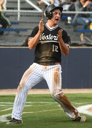 4-26-17<br /> Cass vs Western baseball<br /> Western's Tyler Knepley celebrates after scoring the first run for the Panthers.<br /> Kelly Lafferty Gerber | Kokomo Tribune