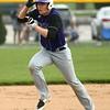 4-15-17<br /> Northwestern vs Mississenewa baseball<br /> NW's Ethan Breisch hangs on to his helmet as he dashes to third base.<br /> Kelly Lafferty Gerber | Kokomo Tribune