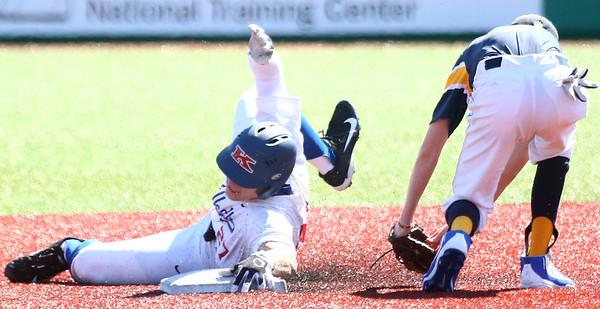 4-8-17<br /> Kokomo baseball vs SB Riley<br /> Bayden Root slides safely to second.<br /> Kelly Lafferty Gerber   Kokomo Tribune