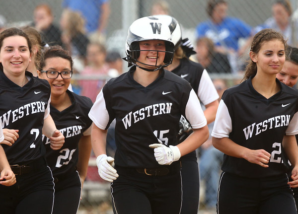 4-14-17<br /> Western vs Tipton softball<br /> Western's Emma Key smiles as she jogs off the field after hitting a homerun and being congratulated by her teammates at home plate.<br /> Kelly Lafferty Gerber | Kokomo Tribune