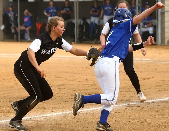 4-14-17<br /> Western vs Tipton softball<br /> Western's Karlyne Shepherd tags Tipton's Julihannah Williams out.<br /> Kelly Lafferty Gerber | Kokomo Tribune