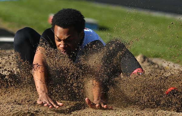 4-7-17<br /> Kokomo boys track and field<br /> Chris Thomas in the long jump.<br /> Kelly Lafferty Gerber | Kokomo Tribune