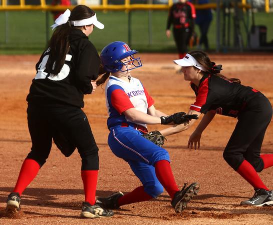4-11-17<br /> Kokomo vs Taylor softball<br /> Kokomo's Kiley Trine gets tagged out by Taylor's Lynzey Butzin as she slides to third.<br /> Kelly Lafferty Gerber   Kokomo Tribune