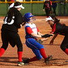 4-11-17<br /> Kokomo vs Taylor softball<br /> Kokomo's Kiley Trine gets tagged out by Taylor's Lynzey Butzin as she slides to third.<br /> Kelly Lafferty Gerber | Kokomo Tribune