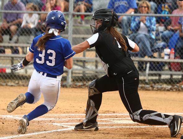 4-14-17<br /> Western vs Tipton softball<br /> Western catcher Kinsey Smith tags Tipton's Tori Holt out at home.<br /> Kelly Lafferty Gerber | Kokomo Tribune