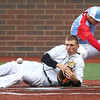 4-27-17<br /> Eastern vs Maconaquah baseball<br /> Eastern defeated Maconaquah in 5 innings, 13-3. Tyler Gilbert watches the ball as he slides safely to home and scores the game-winning run.<br /> Kelly Lafferty Gerber | Kokomo Tribune