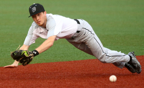 4-19-17<br /> Western vs Northwestern baseball<br /> Western's Cooper O'Neal just misses the catch.<br /> Kelly Lafferty Gerber | Kokomo Tribune