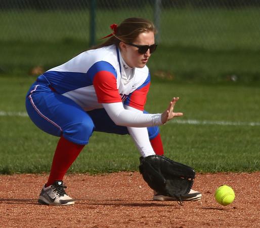 4-11-17<br /> Kokomo vs Taylor softball<br /> Kokomo's Paige Ward scoops up the ball and throws to first for an out.<br /> Kelly Lafferty Gerber | Kokomo Tribune