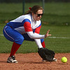 4-11-17<br /> Kokomo vs Taylor softball<br /> Kokomo's Paige Ward scoops up the ball and throws to first for an out.<br /> Kelly Lafferty Gerber | Kokomo Tribune