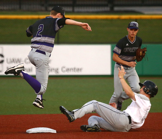 4-19-17<br /> Western vs Northwestern baseball<br /> NW's Collin Hodson gets Western's Cooper O'Neal out at second.<br /> Kelly Lafferty Gerber | Kokomo Tribune