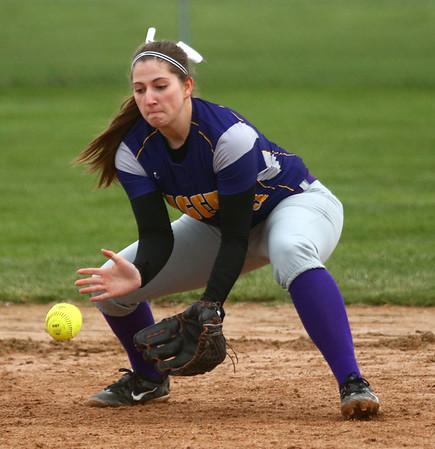 2-14-17<br /> Northwestern vs Oak Hill softball<br /> Sophia Beachy scoops up the ball.<br /> Kelly Lafferty Gerber | Kokomo Tribune