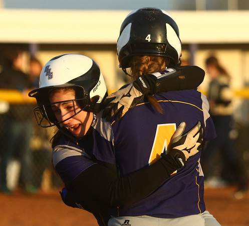 2-14-17<br /> Northwestern vs Oak Hill softball<br /> Sophia Beachy, left, hugs Chase Butcher after Butcher makes the game-winning hit.<br /> Kelly Lafferty Gerber | Kokomo Tribune
