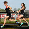 4-25-17<br /> Taylor track<br /> Austyn Huffer hands off to Ayden Richter in the 4x100.<br /> Kelly Lafferty Gerber | Kokomo Tribune