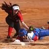 4-11-17<br /> Kokomo vs Taylor softball<br /> Kokomo's Taylor Turnbow is safe as she slides back to third before Taylor's Lynzey Butzin can get her out.<br /> Kelly Lafferty Gerber | Kokomo Tribune